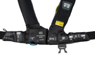 The Spinlock Harness Release System (HRS) is a new innovation which enables the wearer to disconnect from the safety line by releasing a lever behind the soft loop safety line attachment point of the lifejacket harness. Staying connected to the boat is undoubtedly safer than being in the water and use of a safety line is actively encouraged. However, in the event of a fall overboard, a casualty can find themselves being dragged/trapped alongside or behind the vessel. A situation which can be hard to be released from.